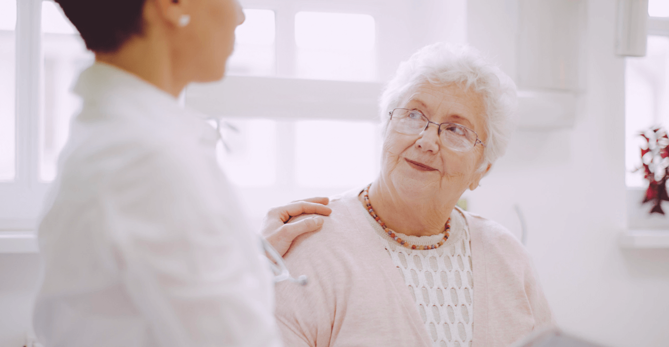 A clinician speaks to an elderly patient. An ACP program should be an ongoing, patient-centered conversation.